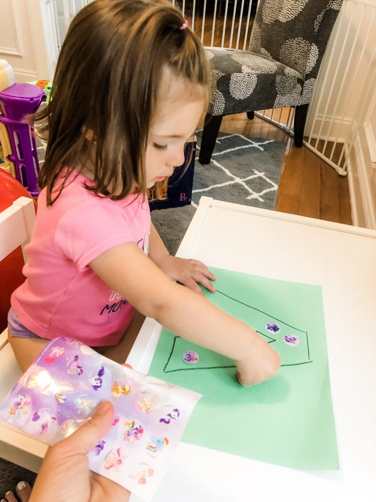 If your toddler is interested in learning their alphabet, teach them the letters using this fine motor activity. Peeling stickers onto a large letter is great way to use a multi-sensory approach to learning.