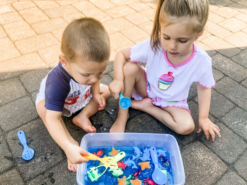 This ocean scene jell-o dig sensory bin activity is great for babies, toddlers, or even preschoolers to explore and learn through play outside in the summer
