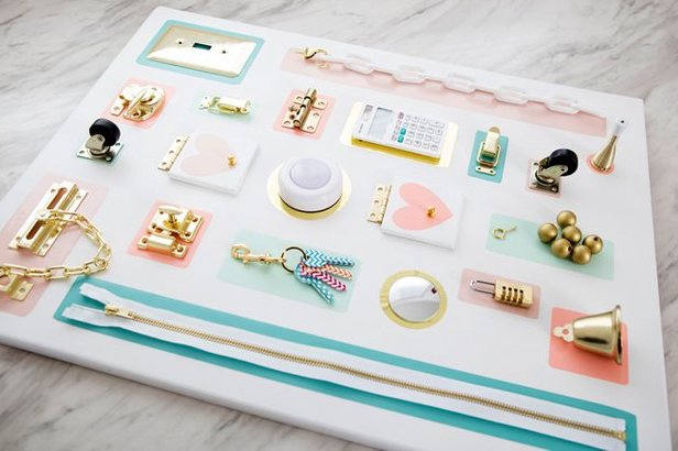 Get creative by making your own toddler busy board for your child so they can learn & explore sensory objects & toys in one place. These busy board ideas will definitely keep you busy while making them, but your child will get tons of enjoyment out of it!