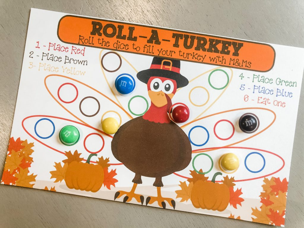 Use this free printable roll-a-turkey game for your preschoolers and young children on Thanksgiving for learning and fine motor skills