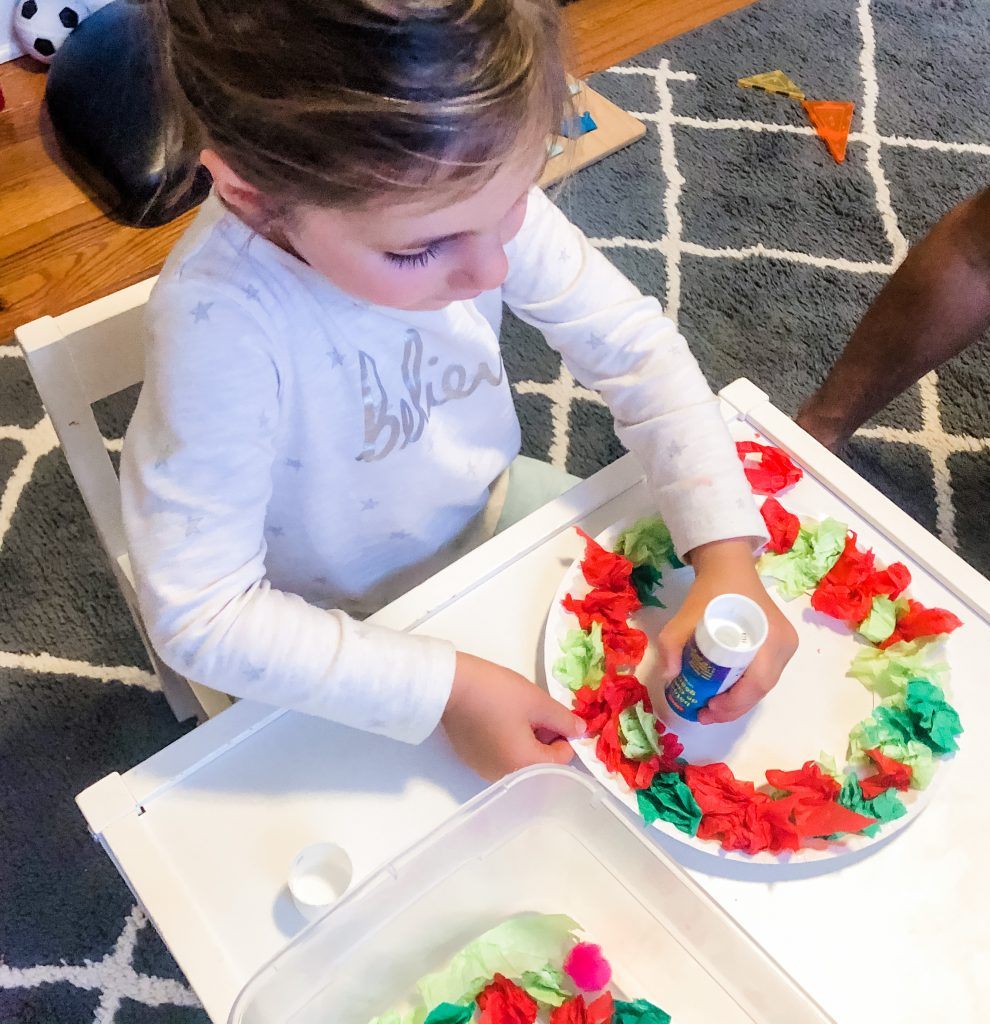 Toddlers and Preschoolers will love this fun tissue paper Christmas activity. Help them build fine motor skills, math and language skils
