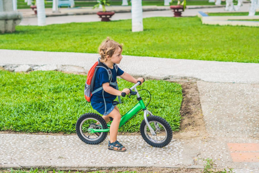 It's so easy to teach a kid to ride a bike when using a balance bike to begin instead of the standard training wheels. Here's some great tips on how to do it quickly and safely.
