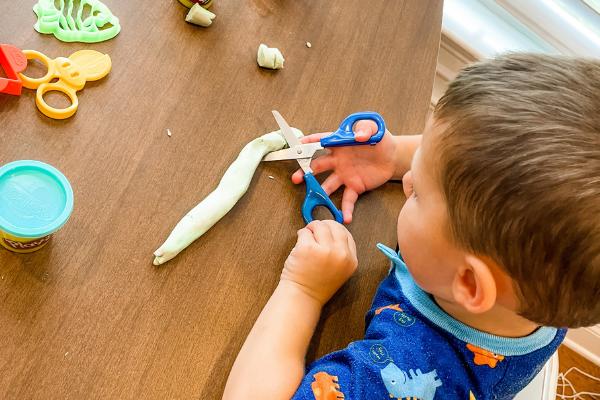Teach Scissor Skills by Cutting Play-Doh